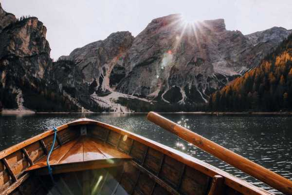 brown-canoe-in-the-body-of-water-near-mountain-675764